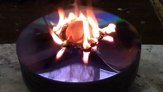 Red Hot Nickel Ball on a Stack of CDs - Video