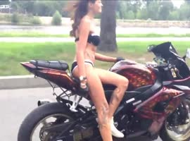 Hot chick in white indicates the number of motor. - Video