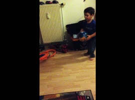 Boy Has Fun Playing Soccer At Home - Video