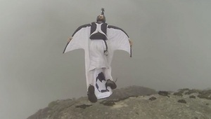 Wingsuit Base Jumper Lands Through Roof - Video