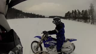 Dirt Bike Snow Wheelie Doesn't Go as Planned - Video