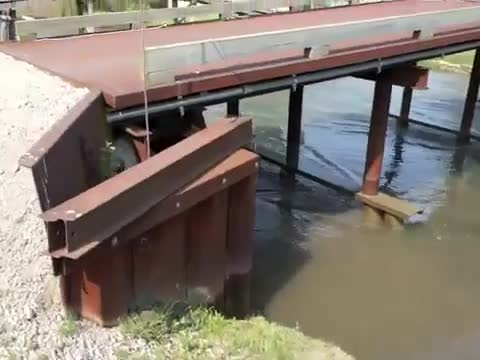 Massive Ship Displaces Water In River