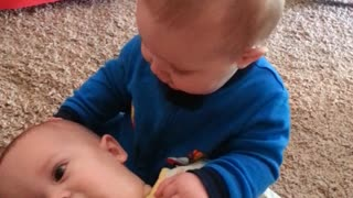 A successful twin baby brother kiss, or not? - Video