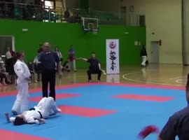 Girl Knocks Down Opponent with Surprise Kick