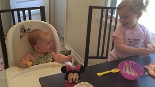 Adorable baby enjoys a laugh with her sister - Video
