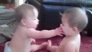Two children fighting over a nipple. - Video
