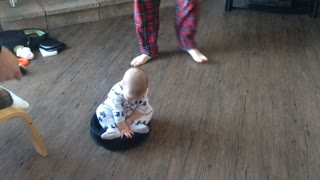 Adorable Baby Rides Roomba! - Video
