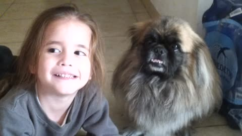 Daughter and Dog Smile for the Camera!