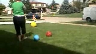 Little Girl vs Big Yellow Dodge Ball - Video