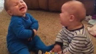 Twin Babies Have Adorable Fight - Video