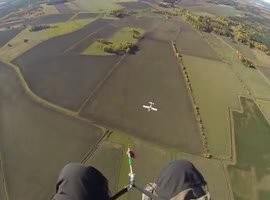Paraglider Has Very Scary Encounter - Video