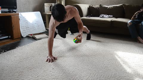 One-Handed Push-Ups While Solving Rubik's Cube