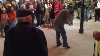 Elderly man shows off smooth dance moves - Video
