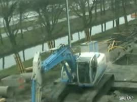 Excavator Ends Up on Its Side - Video