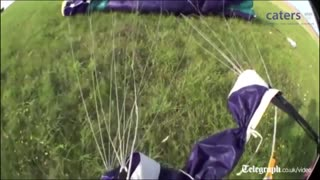 Dramatic moment unconscious skydiver rescued_mid-air_captured_on_helmet_camera - Video
