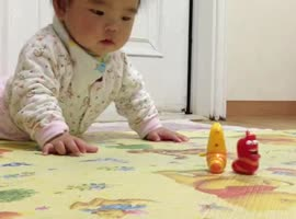 Baby Gets Emotional Over Moving Toys! - Video