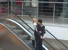 blonde and escalator - Video