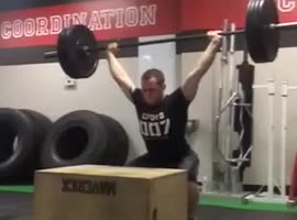 Man Jumps on Box Lifting 135 lb. Weight!