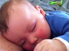 Sleeping Baby Laughs - Video