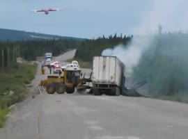 Water Bomber Cools Off Truck Accident - Video