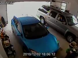 Woman Can't Back Car out of garage