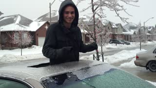 Breaking Out of a Frozen Car! - Video