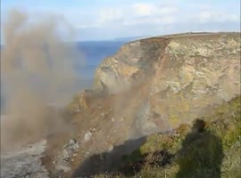 Mountainside Cliff Crashes Into Water - Video