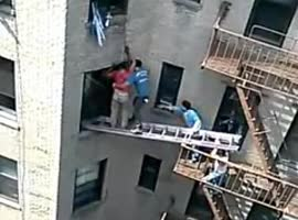 MEN RESCUE MAN FROM BURNING APARTMENT
