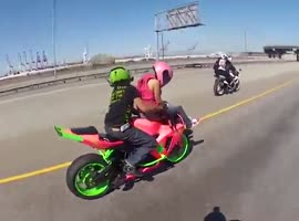 Couple Perform Insane 69 Wheelie - Video
