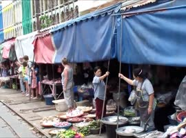 Train Passes Through Busy Market - Video