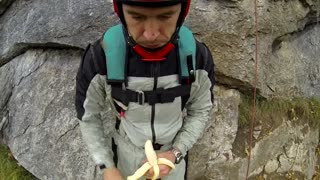 This Guy Eats A Banana During A Base Jump