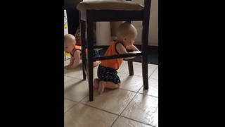 Baby stuck under chair comes up with genius idea