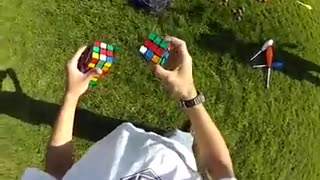 Solving three cubes while juggling them - Video
