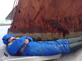 Waking Up a Sleeping Russian With a Sunken Boat - Video