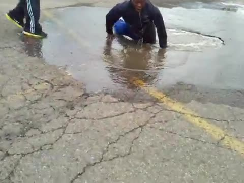 Crazy jump in a puddle