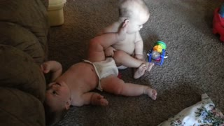 Adorable Baby Kicks Twin Brother Over - Video