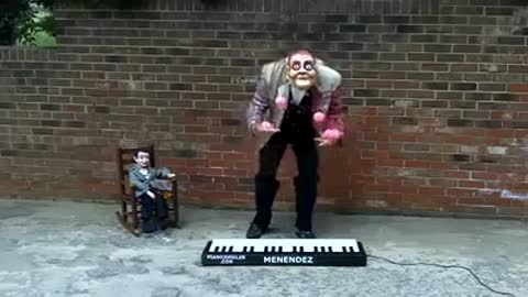 Unique talent! Man playing piano with balls