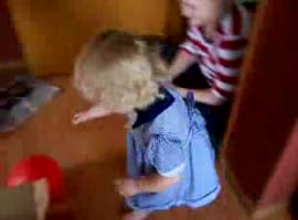 little girl playing with a small cat - Video