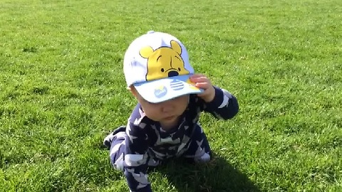 Baby Adorably Struggles to Take Off His Hat