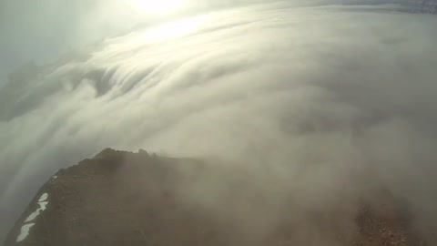 Stunning Base Jump Into the Clouds