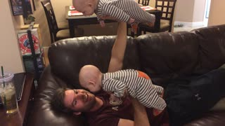 Dad Bench Presses Twin Babies