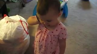 Cute baby girl talking on phone - Video