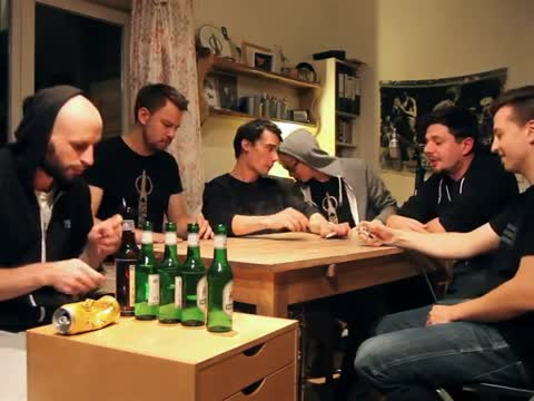 German Band Plays a Song around a Table with No Music Instruments