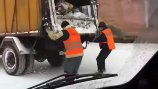 Garbage Men Slide on Snowy Road! - Video