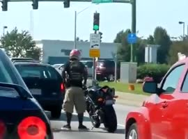 Motorcycle Rider Dances at Intersection
