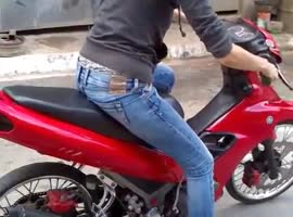 Girl tries to ride scooter - Video