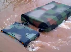 National Guard Trucks Underwater and Doesn't Make It - Video