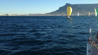 Lovely summer sailing yachts on blue water and Table Mountain as a backdrop. - Video