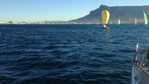 Lovely summer sailing yachts on blue water and Table Mountain as a backdrop.