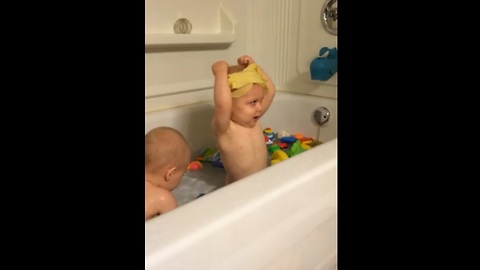 Adorable baby can't get washcloth off his head
